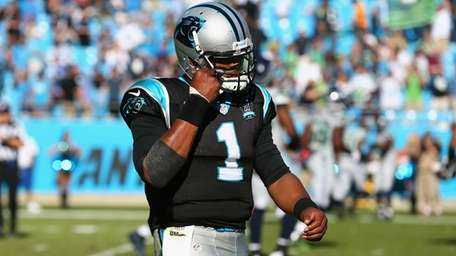 Cam Newton of the Carolina Panthers leaves the