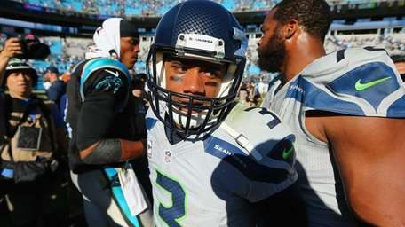 Russell Wilson of the Seattle Seahawks leaves the