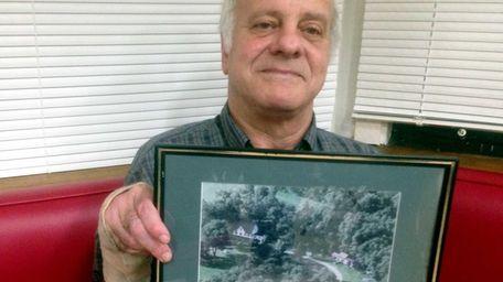 Douglas Lederman, 65, of Kings Park, holds an