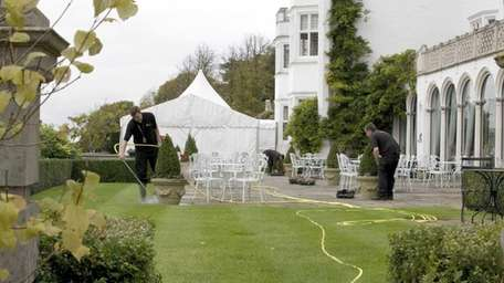 Gardeners prepare the grounds at Danesfield House, in