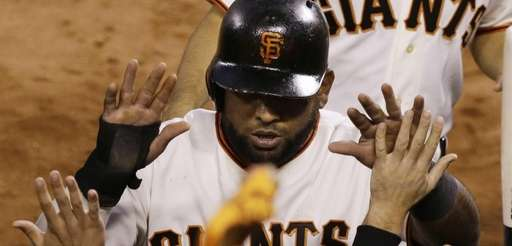 San Francisco Giants' Pablo Sandoval is congratulated by