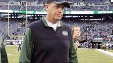 Head coach Rex Ryan of the Jets walks