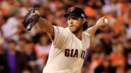 Madison Bumgarner of the San Francisco Giants pitches