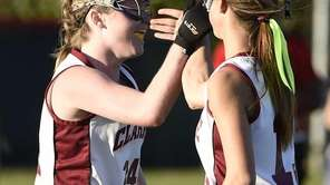 Clarke's Bailey McNamara, left, is congratulated by Jessica