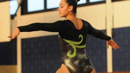 Sara Veleno of Harborfields performs on the balance