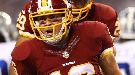 Colt McCoy #16 of the Washington Redskins reacts