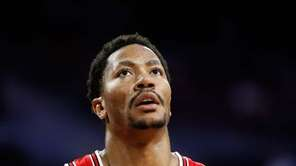 Chicago Bulls guard Derrick Rose watches against the