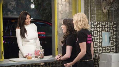 Kim Kardashian West, left, appears as herself on