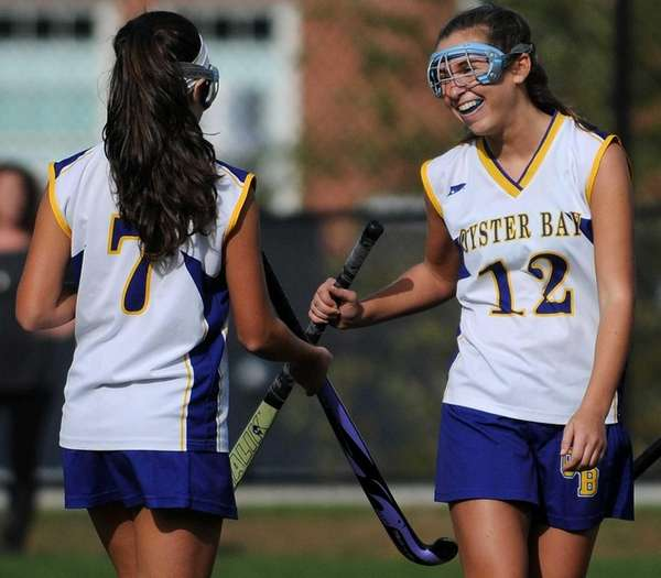 Oyster Bay's Shelby Cook, right, congratulates Lia Stanco
