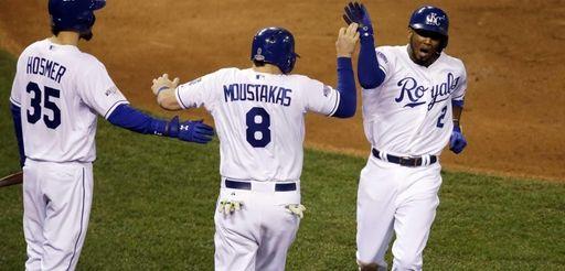 The Kansas City Royals' Alcides Escobar (2) celebrates