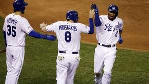 The Kansas City Royals' Alcides Escobar (2) celebrates