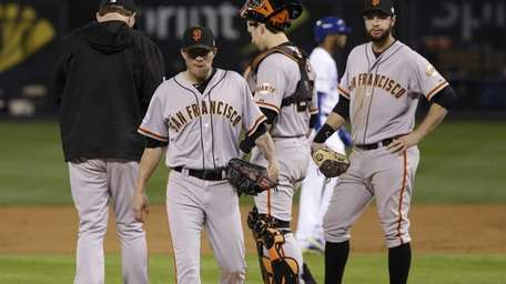San Francisco Giants pitcher Jake Peavy, second left,
