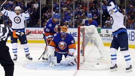 Jaroslav Halak of the Islanders looks on after