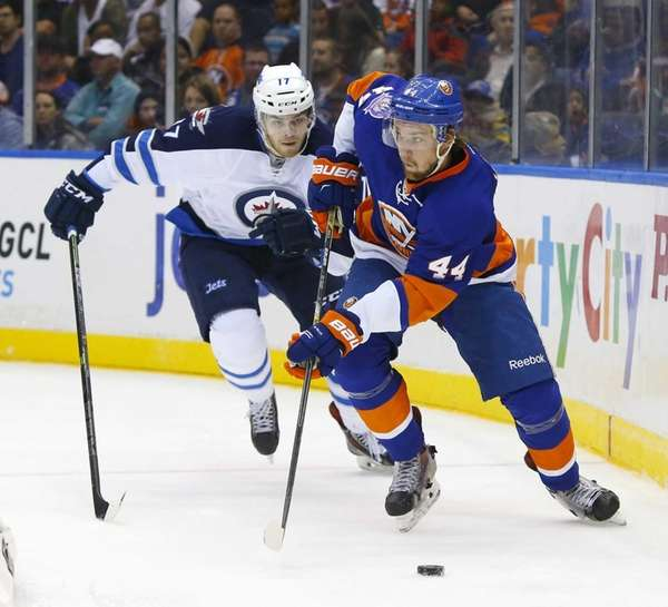 Calvin de Haan of the Islanders skates with
