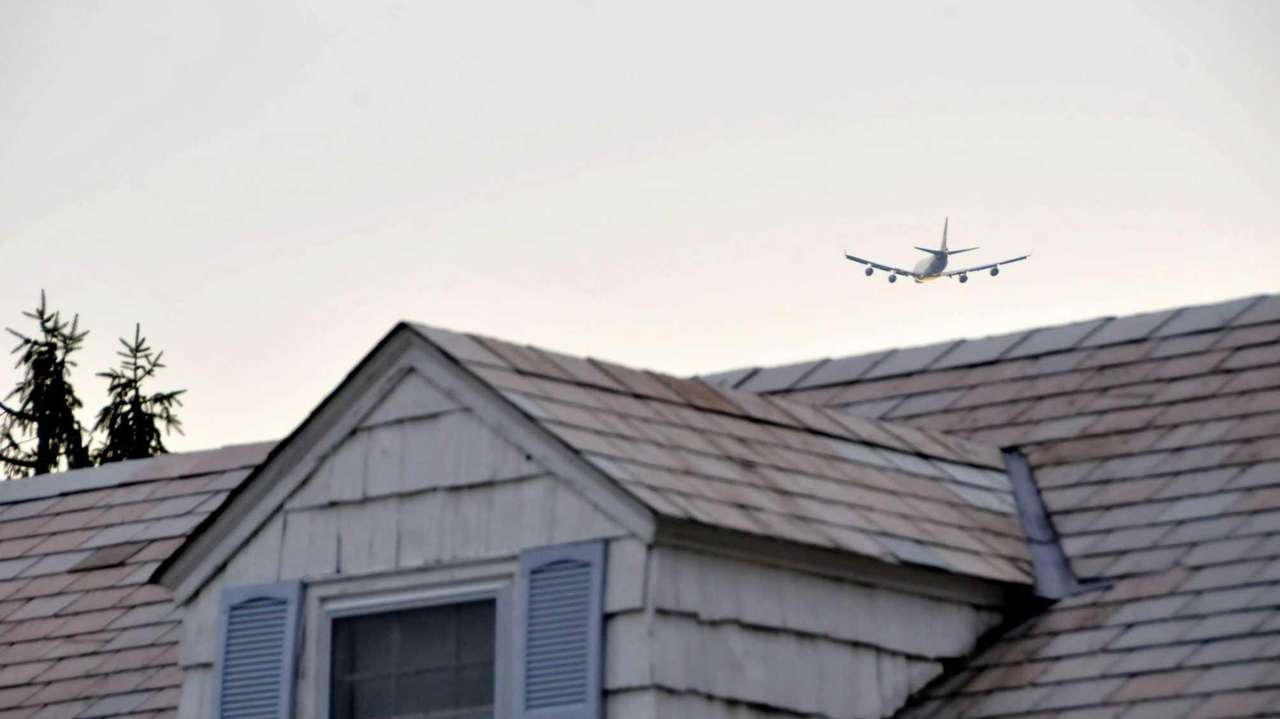 Planes fly over Canterbury Lane in Roslyn Tuesday,