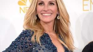 Julia Roberts arrives at the 66th Primetime Emmy