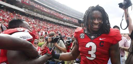 Georgia running back Todd Gurley celebrates with linebacker
