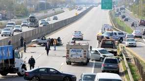 Vehicles turn around the westbound Sunrise Highway and
