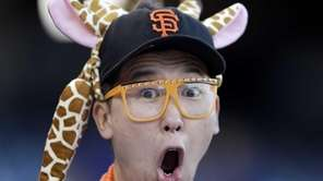 A San Francisco Giants fan yells during batting