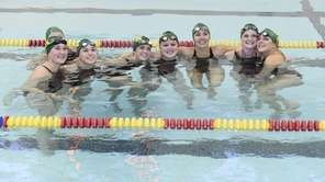 Ward Melville swimmers pose for a photo before