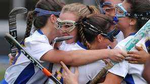 East Meadow's Kelly Clarke, second from left, gets