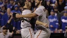 San Francisco Giants' Madison Bumgarner and catcher Buster