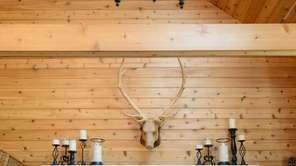 A custom built fireplace mantle and cedar tongue