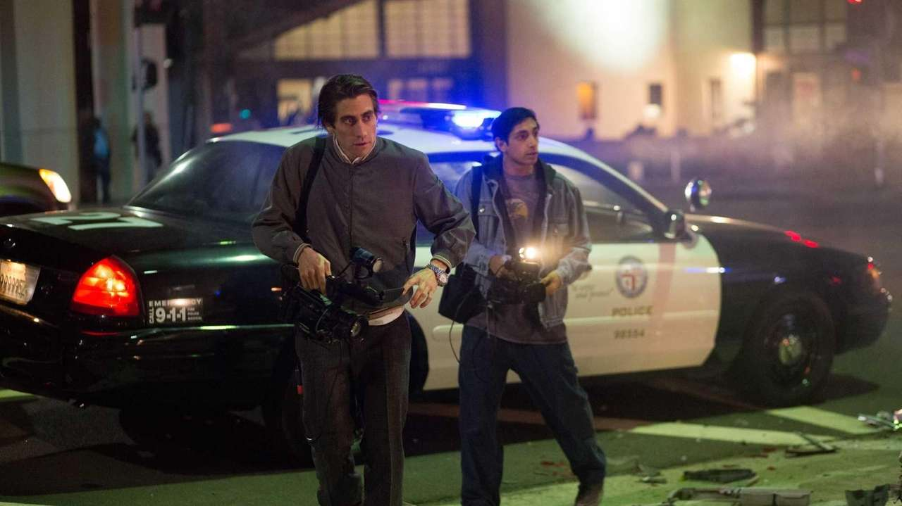 Jake Gyllenhaal as Lou Bloom and Riz Ahmed