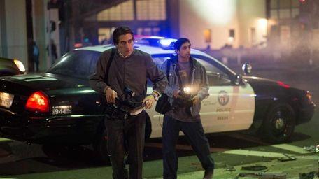 Jake Gyllenhaal as Lou Bloom and Riz Ahmed