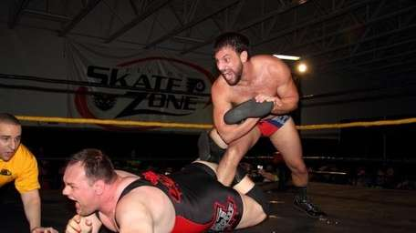 DJ Hyde gets pinned by Drew Gulak during