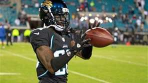Jacksonville Jaguars cornerback Mike Harris warms up before