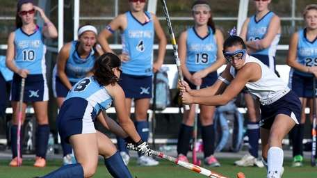 Miller Place's Crystal Esposito looks to pass as