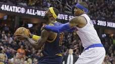 Knicks' Carmelo Anthony, right, grabs Cleveland Cavaliers' LeBron