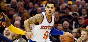Shane Larkin of the Knicks controls the ball