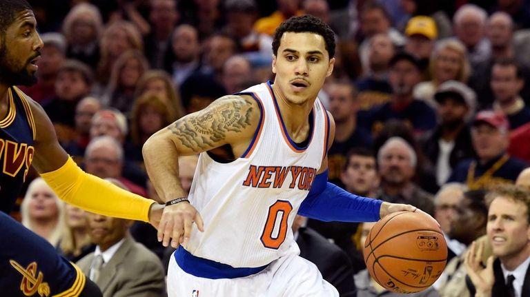Shane Larkin of the Knicks controls the ball