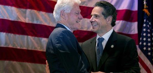 Former President Bill Clinton embraces Gov. Andrew M.