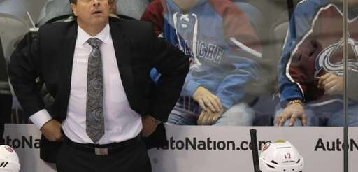 Islanders head coach Jack Capuano, back, reacts after