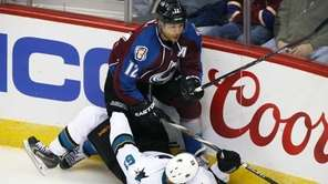 Colorado Avalanche right wing Jarome Iginla knocks over