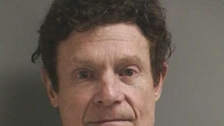 Marshall Hubsher, 64, of Sands Point, was arrested
