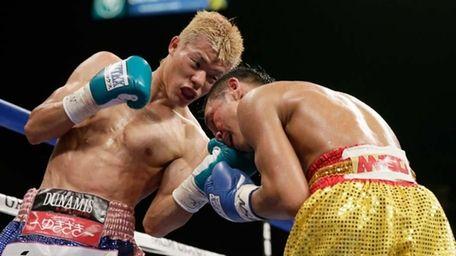 Tomoki Kameda, of Japan, left, punches Pungluang Singyu