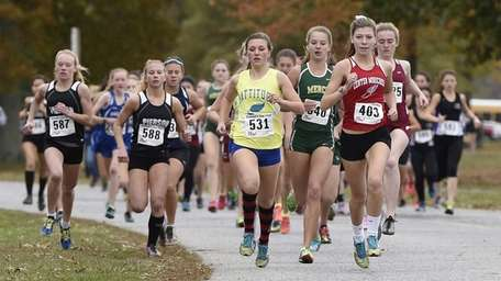 Center Moriches' Ryleigh Donegan, front, leads the girls