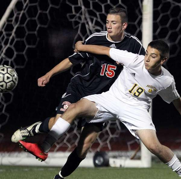 Syosset's Max Verch defends in front of his