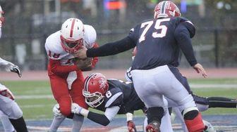 Freeport quarterback Rashad Tucker is tackled during a