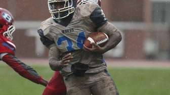 Riverhead's Raheem Brown runs up the middle against