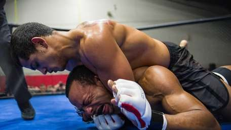 Nyko Harrynarine of Bellmore Kickboxing (top) forces Paul