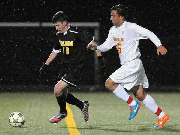 St. Anthony's Ryan Goncalves, left, gets pressured by