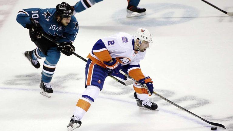 Islanders' Nick Leddy is chased by San Jose