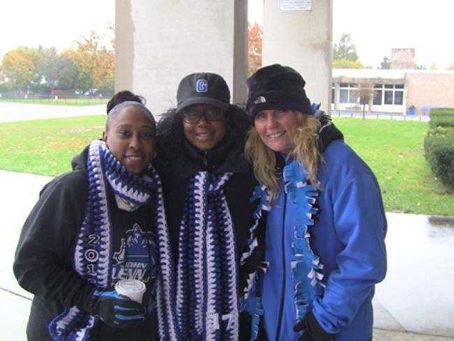 Football moms, from left, Camille Mason, Felicia White,