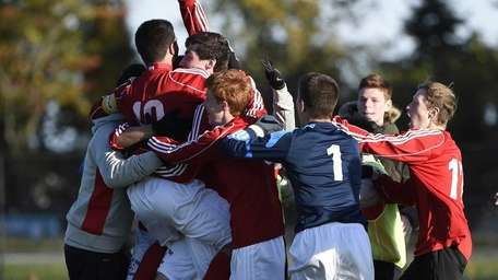 South Side players mob Alessandro Pugliese (10) after