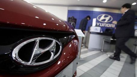 A Hyundai Motor Co. logo on a vehicle